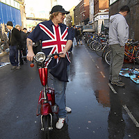 Man wearing a union jack shirt with a red moped, Brick Lane market, London