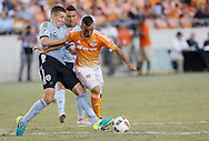 Jun 29, 2016; Houston, TX, USA; Sporting Kansas City defender Matt Besler (5) and Houston Dynamo midfielder Alex (14) fight for possession in the second half at BBVA Compass Stadium. Dynamo won 3 to 1. Mandatory Credit: Thomas B. Shea-USA TODAY Sports