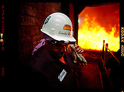 Seretha Woods-Bradford, 55, who has worked for Indiana Harbor Coke Company for about 29 years is responsible for control operations as well as doing walk around inspections of the four coke batteries. Each battery is about a quarter mile in length and bakes coal into coke at around 2600 degrees farinheit. The coke ovens take about 36 to 48 hours to bake around 40 tons of coal. During a push which, is the term for emptying an oven of coke a train called a hot car is loaded with coke and driven to the quench where 7000 to 8000 gallons of water are poured over the glowing coke.