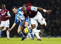 Photo: Chris Ratcliffe.<br />West Ham United v Wigan Athletic. The Barclays Premiership. 28/12/2005.<br />Marlon Harewood (R) of West Ham tussles with Leighton Baines of Wigan.