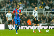 Luka Milivojevic (#4) of Crystal Palace indicates to his team mates to calm down following scoring Crystal Palace's first goal (0-1) during the Premier League match between Newcastle United and Crystal Palace at St. James's Park, Newcastle, England on 6 April 2019.