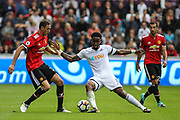 Leroy Fer of Swansea City under pressure from Nemanja Matic of Manchester United during the Premier League match between Swansea City and Manchester United at the Liberty Stadium, Swansea, Wales on 19 August 2017. Photo by Andrew Lewis.