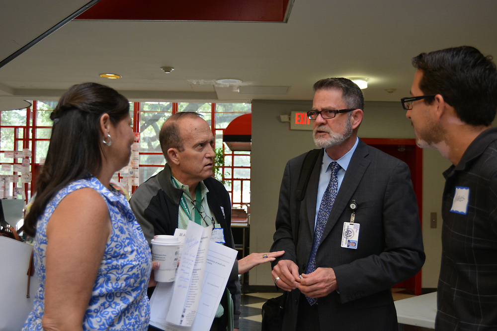 Arts Access Initiative Meet & Greet at HSPVA, where school representatives get a chance to talk to partnering arts organizations. Fine Arts Director Wenden Sanders (second from right) talks with AAI representatives, including Ted Wills from Brookline ES (second from left).