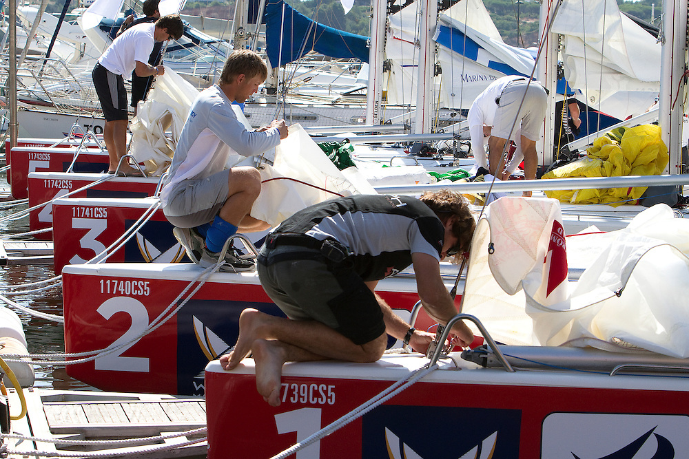 Crews prepare the boats for racing. Portimao Portugal Match Cup 2010. World Match Racing Tour. Portimao, Portugal. 23 June 2010. Photo: Gareth Cooke/Subzero Images