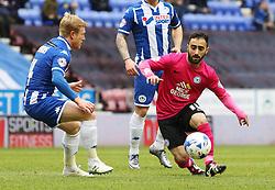 Erhun Oztumer of Peterborough United gets away from David Perkins of Wigan Athletic - Mandatory byline: Joe Dent/JMP - 05/03/2016 - FOOTBALL - DW Stadium - Wigan, England - Wigan Athletic v Peterborough United - Sky Bet League One