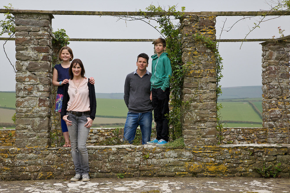 Baker family in the rose arbour at Pickwell Manor. From left to right: Liza Baker (9), Susannah Baker, Steve Baker, Zac Baker (11). Pickwell Manor, Georgeham, North Devon, UK.<br /> CREDIT: Vanessa Berberian for The Wall Street Journal<br /> HOUSESHARE