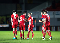 NEWPORT, WALES - Tuesday, October 16, 2018: Wales' Joseff Morrell celebrates scoring his teams first goal with team mates during the UEFA Under-21 Championship Italy 2019 Qualifying Group B match between Wales and Switzerland at Rodney Parade. (Pic by Laura Malkin/Propaganda)