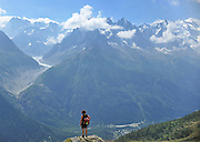 FRANCE CHAMONIX: Ramblers walk through the French Alps and admire the views across the Chamonix Valley of Mt Blanc and the surrounding glaciers and mountain range. 10 August 2010. STEPHEN SIMPSON...