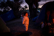 Many smal child are living outside the Moria camp in a  olive trees plantation. About 8500 migrants and refugees are living in hard condition on the island of Lesvos, many of them outside the organized camp. Moria, Greece. December 12th 2017.