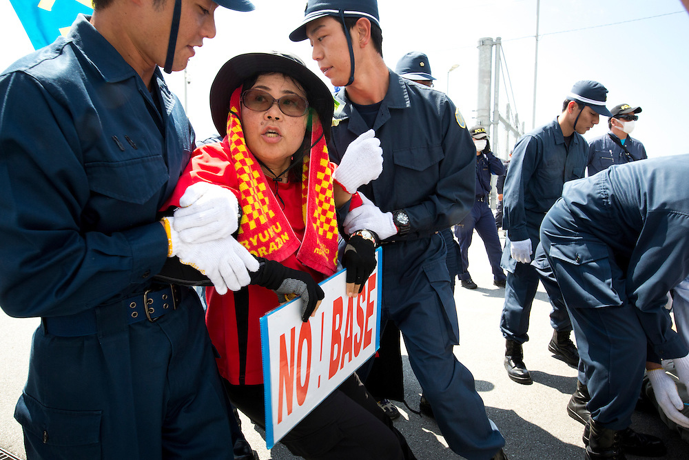 OKINAWA, JAPAN - JUNE 17 : Police officers try to remove protesters staging a sit-in front of Camp Schwab during the Anti U.S. Base relocation protests outside the Camp Schwab on June 17, 2016 in Nago, Okinawa, Japan. Protests have grown more intense in the past days due to the past incident of rape of a Japanese woman and drunk driving in Okinawa over American military presence in Japan. Photo: Richard A. de Guzman