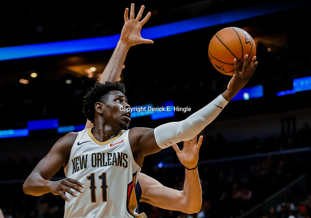 Jan 20, 2018; New Orleans, LA, USA; New Orleans Pelicans guard Jrue Holiday (11) shoots over Memphis Grizzlies center Marc Gasol (33) during the second half at the Smoothie King Center. The Pelicans defeated the Grizzlies 111-104. Mandatory Credit: Derick E. Hingle-USA TODAY Sports