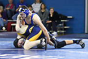 Madison's Lynn Welch wrestles Rappahannock's Cody Casey during Saturday's Bull Run District Duals wrestling match.  Lynn defeated Casey 15-0 in the 125 lb class.  Date:  January/23/10, MCHS Wrestling vs Rappahannock Panthers, Bull Run District Duals, Madison defeats Rappahannock 49-27.