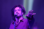 "Lead singer Adam Duritz performs with Counting Crows Tuesday night at the Morris Performing Arts Center in South Bend. The band offered new music from their ""Hard Candy"" release, as well as all-acoustic set that included ""Mr. Jones"" and ""Angels of the Silences."""