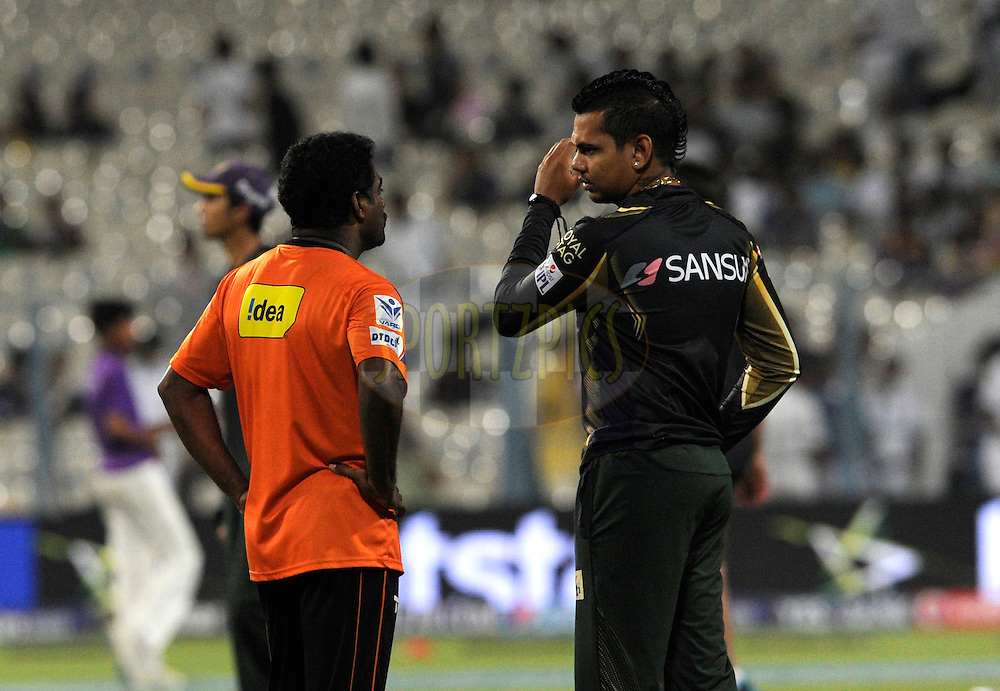Muttiah Muralitharan bowling coach of Team Sunrisers Hyderabad shares his bowling tips with Sunil Narine of Kolkata Knight Riders during match 38 of the Pepsi IPL 2015 (Indian Premier League) between The Kolkata Knight Riders and The Sunrisers Hyderabad held at Eden Gardens Stadium in Kolkata, India on the 4th May 2015.<br /> <br /> Photo by:  Pal Pillai / SPORTZPICS / IPL