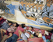 Passengers sleep on the deck's floor of KM Tidar that sail passing ten ports from Jakarta to Papua. Thanks to the limited voyage schedule, the ship often sails over its capacity. The passengers have to struggle to get a bed to rest.<br /> <br /> Indonesia&rsquo;s Pelni is the last great true passenger liners company in the world. It is the only company of its size that still serves scheduled vessels transporting people across various destination. In a far-flung archipelago nation, where many of the islands have no airport and most of its area made up of water, it is one important mean of transportation&mdash;and simply one of the best way to travel. One of Pelni's furthest regular route starts from Surabaya in East Java and ends in Papuan city of Merauke, basically the eastern end of Indonesia. The round trip voyage takes one month, passing more than two dozen ports and covering a distance of more than 8,000 kilometers.
