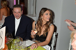 CHARLES SAATCHI and ELIZABETH HURLEY at the QBF Spring Gala in aid of the Red Cross War Memorial Children's Hospital hosted by Heather Kerzner and Jeanette Calliva at Claridge's, Brook Street, London on 12th May 2015.