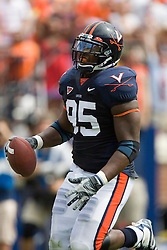 Virginia defensive end Jeffrey Fitzgerald (95) returns an interception for a touchdown.  The Virginia Cavaliers football team faced the Georgia Tech Yellow Jackets at Scott Stadium in Charlottesville, VA on September 22, 2007.