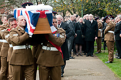 Matt Thorntons parents Michael and Susan follow thier sons coffin into All Saints Church Darton Barnsley on Tuesday Morning.. Funeral of Private Matthew Adam Thornton, Territorial Army Soldier with 4th Battalion The Yorkshire Regiment who was killed on the 9th of November 2011 while deployed to Afghanistan with Support Company 1st Battalion the Yorkshire Regiment. .Private Thornton was killed just 6 days after his 28th Birthday and 2 days before Armistice Day. ..29 November 2011  Image © Paul David Drabble