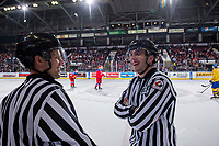KELOWNA, BC - DECEMBER 18:  Linesmen Dustin Minty and Tim Plamondon stand at the boards during a time out at Prospera Place on December 18, 2018 in Kelowna, Canada. (Photo by Marissa Baecker/Getty Images)***Local Caption***