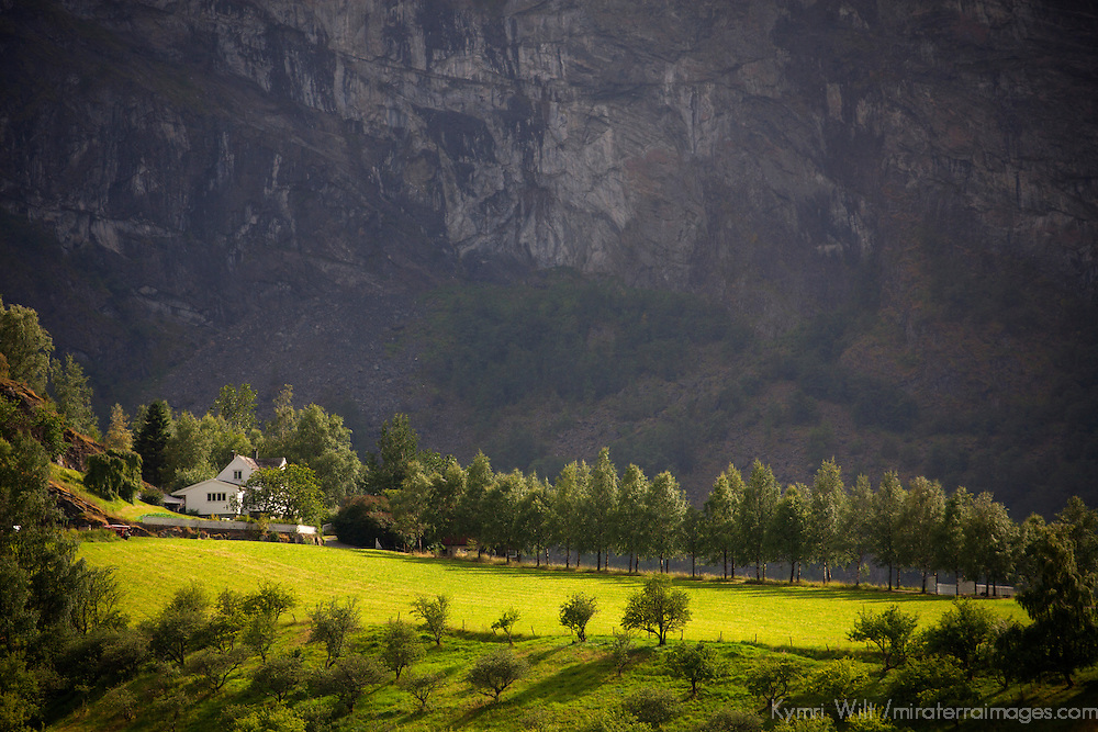 Europe, Norway, Flam. Sunlit farm in Flam mountains.