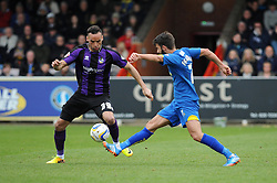 Bristol Rovers' Kaid Mohamed challenges AFC Wimbledon's George Francomb to the ball - Photo mandatory by-line: Dougie Allward/JMP - Mobile: 07966 386802 05/04/2014 - SPORT - FOOTBALL - Kingston upon Thames - Kingsmeadow - AFC Wimbledon v Bristol Rovers - Sky Bet League Two