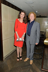 OLIVIA COLE and MICK HUCKNALL at the 3rd birthday party for Spectator Life magazine hosted by Andrew Neil and Olivia Cole held at the Belgraves Hotel, 20 Chesham Place, London on 31st March 2015.