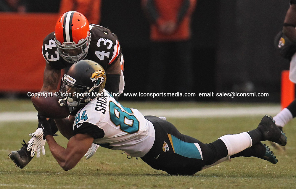 Dec. 1, 2013 - Cleveland, OH, USA - Cleveland defensive back T. J. Ward, left, breaks up a pass intended for Jacksonville wide receiver Cecil Shorts III at FirstEnergy Stadium on Sunday, Dec. 1, 2013, in Cleveland, Ohio. The Jaguars defeated the Browns, 32-28
