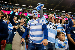 Supporters celebrate after Argentina win the match - Mandatory byline: Rogan Thomson/JMP - 07966 386802 - 18/10/2015 - RUGBY UNION - Millennium Stadium - Cardiff, Wales - Ireland v Argentina - Rugby World Cup 2015 Quarter Finals.