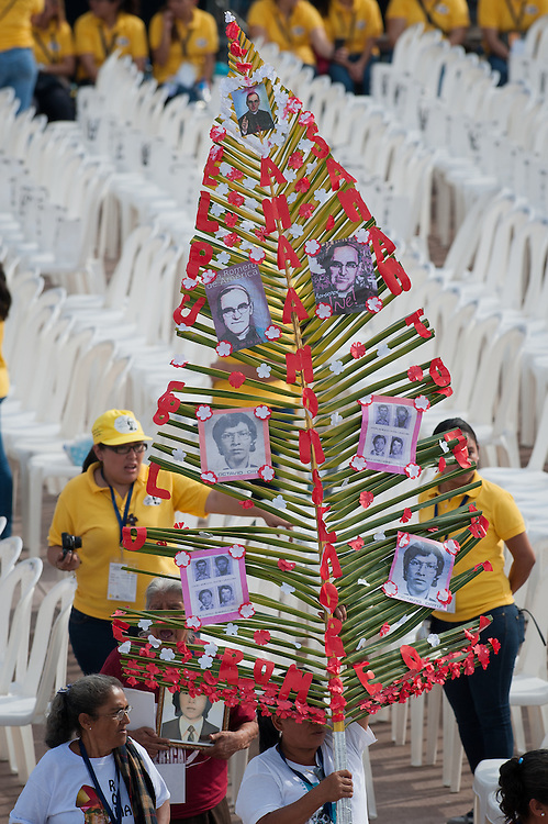 Pilgrims carry palm fronds with photos of martyrs including Archbishop Oscar Romero as El Salvador celebrated the beatification ceremony and mass announcing the beatification of Archbishop Oscar Romero. The Archbishop was slain at the alter of his Church of the Divine Providence by a right wing gunman in 1980. Oscar Arnulfo Romero y Galdamez became the fourth Archbishop of San Salvador, succeeding Luis Chavez, and spoke out against poverty, social injustice, assassinations and torture. Romero was assassinated while offering Mass on March 24, 1980.