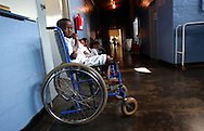 Young South African boy waits to take a shower in the pediatric ward at Ngwelezana Hospital in Empangeni, South Africa on Wednesday, September 13, 2006.