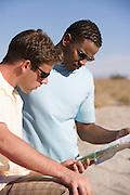Men Looking at Road Map