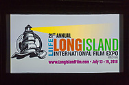 Bellmore, New York, USA. July 18, 2018. At start of final block of film screenings for the 21st Annual LIIFE Long Island International Film Expo, the LIIFE lighthouse and film reel logo and information fill the screen at the Bellmore Movies, the LIIFE location. LIIFE is a nonprofit 501(c)3 Corporation.