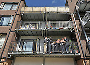 SOUTH BERMONDSEY, LONDON:  Ed Balls conducts media interviews from a balcony on the Housing Project. Ed Balls, Labour Leadership candidate joins shadow housing minister John Healey and  shadow work and pensions secretary Yvette Cooper  during a visit to a housing development, The Falcon Works development, in central London on 31 August 2010. STEPHEN SIMPSON..