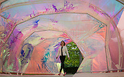 UNITED KINGDOM, London: 22 June 2015 A lady walks through the new Summer Serpentine Pavilion designed by Jose Selgas and Lucia Cano in London, England. Every year the Serpentine hosts a summer pavilion designed by famous architects. This years pavilion was designed by the duo who are a Madrid based firm called Selgascano.  Andrew Cowie / Story Picture Agency