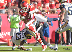 Oct 26, 2014; Kansas City, MO, USA; Kansas City Chiefs tight end Travis Kelce (87) is tackled by St. Louis Rams strong safety T.J. McDonald (25) during the first half at Arrowhead Stadium. The Chiefs won 34-7. Mandatory Credit: Denny Medley-USA TODAY Sports