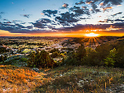 The sun sets on the badlands in the South Unit of Theodore Roosevelt National Park in Medora, North Dakota.