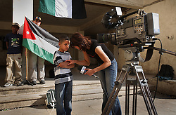 Iraqi refugee Hussein Thamer, 8, is interviewed by Al Arabiya during the first day of school at The Samir Rifai Elementary School for Boys in Amman, Jordan, Aug. 19, 2007. His family fled the violence in Baquba, Iraq two years ago and are waiting for asylum from the U.N. Refugee Agency so they can finally make a permanent home.