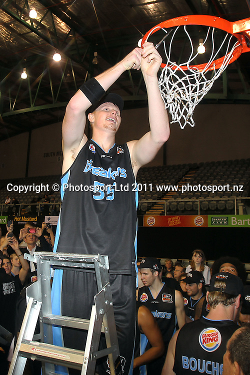 Breakers' Gary Wilkinson cuts the net. iinet ANBL, Grand Final Game 3, New Zealand Breakers vs Cairns Taipans, North Shore Events Centre, Auckland, New Zealand. Friday 29th April 2011. Photo: Anthony Au-Yeung / photosport.co.nz