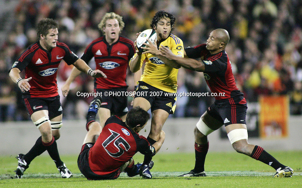 The Hurricanes' Piri Weepu looks to offload as he is tackled by the Crusaders' Mose Tuiali'i (R) and Leon McDonald (C)during the Super 14 rugby union match between the Crusaders and Hurricanes at Jade Stadium, Christchurch, New Zealand on Friday 20 April 2007. The Crusaders won the match 23 - 13. Photo: Hagen Hopkins/PHOTOSPORT<br /><br /><br /><br />200407