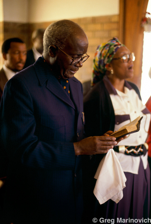 Zambian President Kenneth Kaunda sings from a hymn book at Zinzi Mandela's wedding, Soweto, 25 October 1992. South Africa
