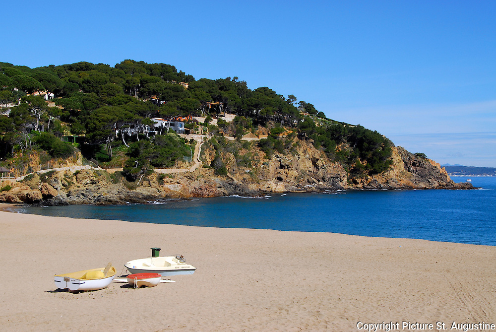 Sa Riera Beach, Cataluyna, Spain. Sa Riera on a sunny spring day. This small beach resort town near Begur, Spain is still doubles as a fishing village on the Mediterranean Sea.