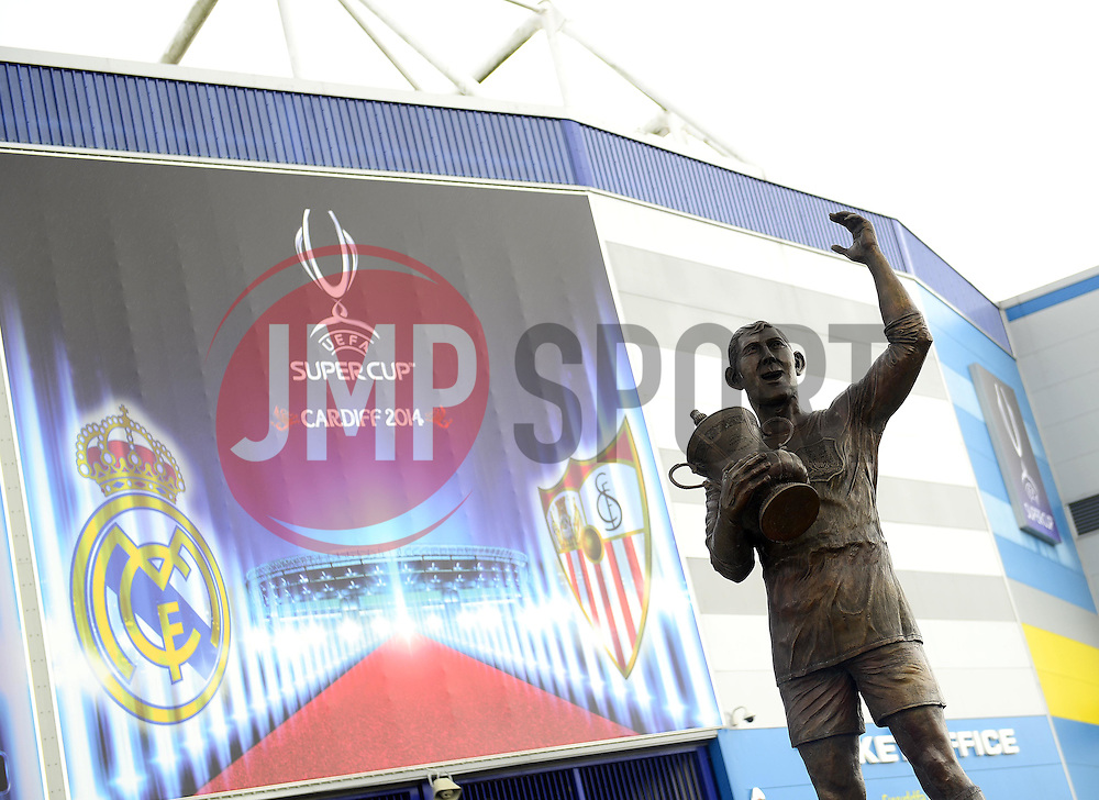 A Statue of former Cardiff city captain, Frederick Charles Keenor sits in front of the Cardiff City Stadium dressed in branding for the Uefa Super Cup 2014 - Photo mandatory by-line: Joe Meredith/JMP - Mobile: 07966 386802 11/08/2014 - SPORT - FOOTBALL - Cardiff - Cardiff City Stadium - Real Madrid v Sevilla - UEFA Super Cup - Press Conference and Open Training session