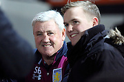 Aston Villa manager Steve Bruce posing for a photo with a fan during the EFL Sky Bet Championship match between Brentford and Aston Villa at Griffin Park, London, England on 31 January 2017. Photo by Matthew Redman.