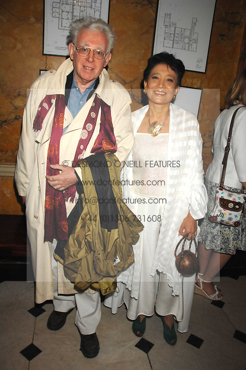 MR JON HALLIDAY and writer JUNG CHANG at the Tatler magazine Summer Party, Home House, Portman Square, London W1 on 27th June 2007.<br />