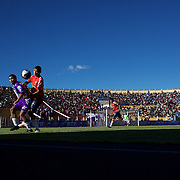 'Attitude at Altitude' Football in Potosi, Bolivia'..Action during the match between Real Potosi and Wilstermann at the The Estadio Victor Agustin Ugarte, Potosi, Bolivia. Real Potosi won the match 3-0. 2nd May 2010. Photo Tim Clayton..'Attitude at Altitude' Football in Potosi, Bolivia'..The Calvario players greet the final whistle with joyous celebration, high fives and bear hugs the players are sprayed with local Potosina beer after a monumental 3-1 victory over arch rivals Galpes S.C. in the Liga Deportiva San Cristobal. The Cup Final, high in the hills over Potosi. Bolivia, is a scene familiar to many small local football leagues around the world, only this time the game isn't played on grass but a rock hard earth pitch amongst gravel and boulders and white lines that are as straight as a witches nose, The hard surface resembles the earth from Cerro Rico the huge mountain that overlooks the town. .. Sitting at 4,090M (13,420 Feet) above sea level the small mining community of Potosi, Bolivia is one of the highest cities in the world by elevation and sits 'sky high' in the hills of the land locked nation. ..Overlooking the city is the infamous mountain, Cerro Rico (rich mountain), a mountain conceived to be made of silver ore. It was the major supplier of silver for the spanish empire and has been mined since 1546, according to records 45,000 tons of pure silver were mined from Cerro Rico between 1556 and 1783, 9000 tons of which went to the Spanish Monarchy. The mountain produced fabulous wealth and became one of the largest and wealthiest cities in Latin America. The Extraordinary riches of Potosi were featured in Maguel de Cervantes famous novel 'Don Quixote'. One theory holds that the mint mark of Potosi, the letters PTSI superimposed on one another is the origin of the dollar sign...Today mainly zinc, lead, tin and small quantities of silver are extracted from the mine by over 100 co operatives and private mining companies who still mine the mountain in poor