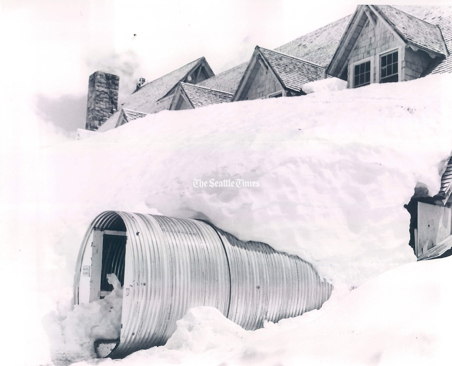 A culvert through the snow provides access to Paradise Lodge, where workers prepared the Mount Rainier National Park landmark for its scheduled opening June 19, 1971. <br />