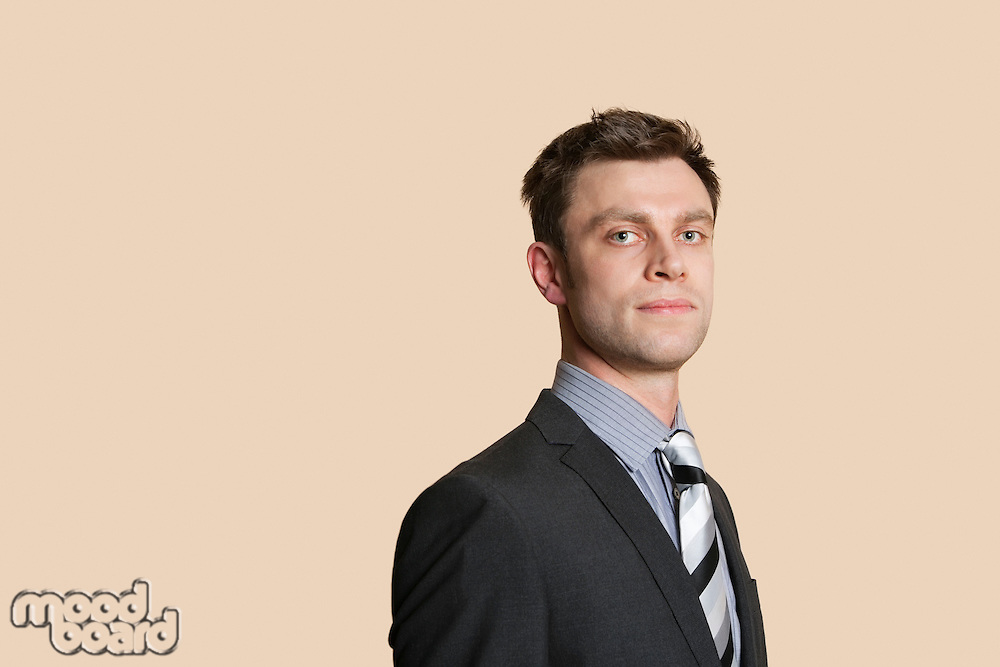 Portrait of a confident mid adult business professional over colored background
