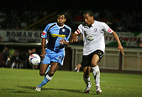 Photo: Rich Eaton.<br /> <br /> Hereford United v Wycombe Wanderers. Coca Cola League 2. 12/09/2006. Wycombes Kevin Betsy left and Tamika Mkandawire of Hereford right go for the ball