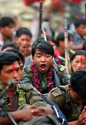 "RUKUM DISTRICT, NEPAL, APRIL 22, 2004:  A Maoist insurgents yawns during a celebration in Rukum district April 22, 2004 weeks after their attack on government troops in Beni when they overran the district headquarters, looting a bank, destroying the jail and torching government office buildings. The government said that 32 security personnel died in the clash and 37 were kidnapped. The clash was one of the deadliest since 1996 when fighting began to topple the constitutional monarchy and install a communist republic. The guerrillas' strength is hard to gauge. Analysts and diplomats estimate there about 15,000-20,000 hard-core fighters, including many women, backed by 50,000 ""militia"".  In their remote strongholds, they collect taxes and have set up civil administrations, and ""people's courts"" to settle rows. They also raise money by taxing villagers and foreign trekkers. Though young, they are fearsome fighters and  specialise in night attacks and hit-and-run raids. They are tough in Nepal's rugged terrain, full of thick forests and deep ravines and the 150,000 government soldiers are not enough to combat this growing movement that models itself after the Shining Path of Peru. (Ami Vitale/Getty Images)"