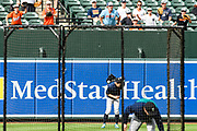 "Baltimore, Maryland - June 25, 2018: Seattle Mariners star Ichiro Suzuki attempts to catch a ball behind his back while shagging balls during batting practice before the Mariners played the Orioles at Camden Yards in Baltimore Monday June 25, 2018. <br /> <br /> Seattle Mariners star Ichiro Suzuki goes through all the pre-game warm ups like any position player on the Seattle Mariners, before their game against the Baltimore Orioles at Camden Yard Monday June 25th  -- except his current position is ""Special Assistant to the Chairman,"" in the ball club's front office.<br /> He does everything an active player does except play. His new position in management forbids him from being in the dugout during game play, so he soaks up as much time with the players before the first pitch. <br /> <br /> CREDIT: Matt Roth for The New York Times<br /> Assignment ID: 30221475A"